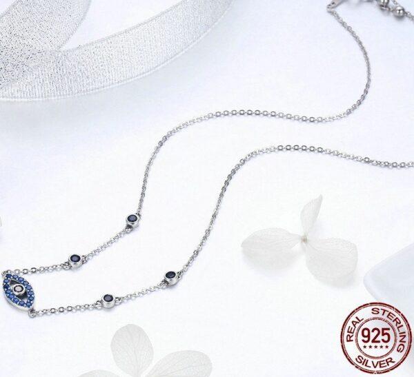 Collier en argent oeil magique serti de zircons bleus et noirs
