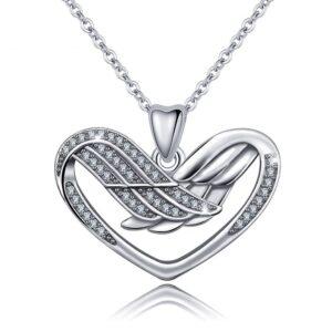 Pendentif coeur en argent renfermant des ailes d'ange serties de fins zircons blancs