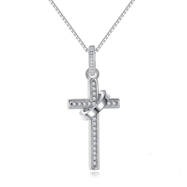 Pendentif croix en argent sertie de zircons blancs recevant un anneau