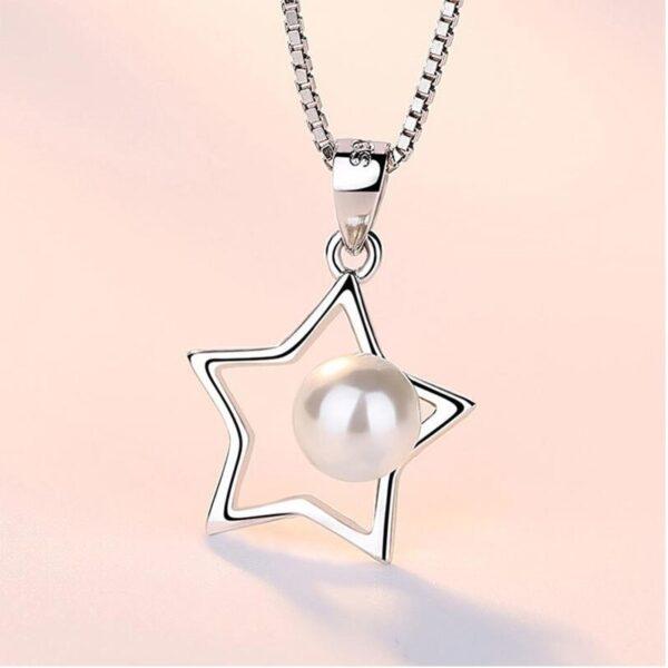Pendentif étoile en argent et sa perle d'eau douce