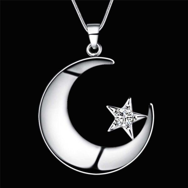 Pendentif lune en métal et son zircon étoilé