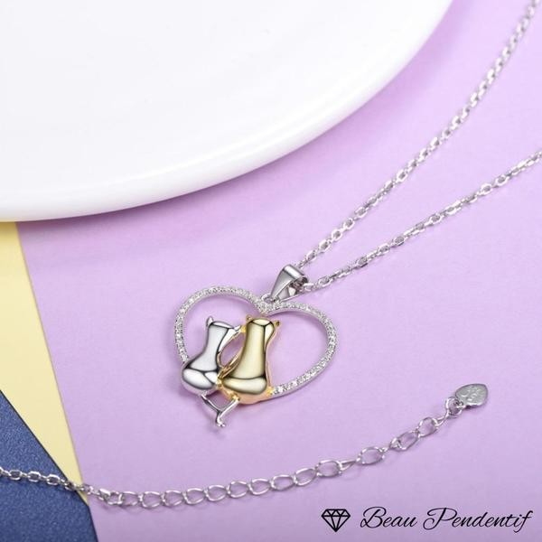 Pendentif chat en argent couple installé dans un coeur serti de zircons
