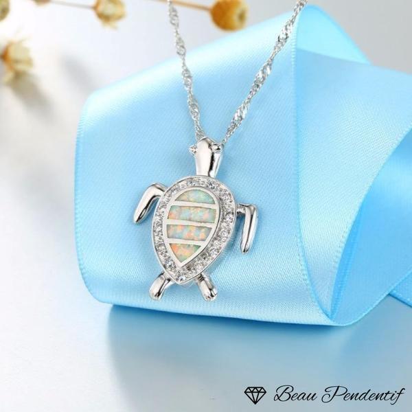 Pendentif tortue en argent et son opale entourée de zircons