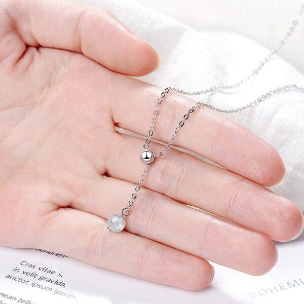 Collier en argent perle suspendue en cristal irisé blanche ou rose
