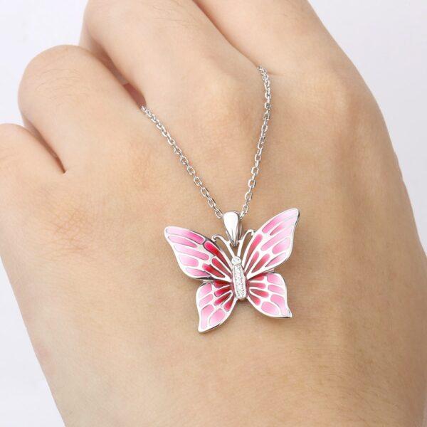 Pendentif papillon en argent aux ailes de rose et au corps de zircons
