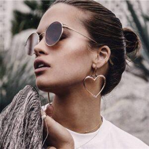 boucles d'oreilles avec lunettes de soleil